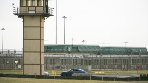 A prison guard stands at one of the towers at James T. Vaughn Correctional Center in this undated photo. (Suchat Pederson / The Wilmington News-Journal)
