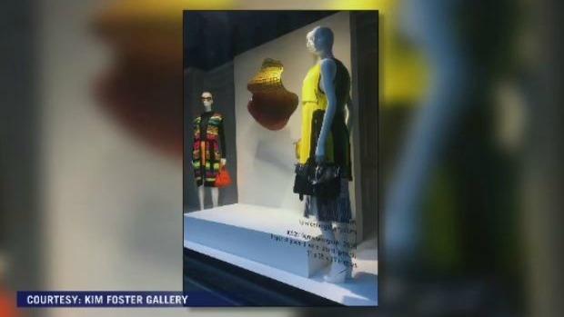 Artist Sydney Blum's work on display in a Saks Fifth Avenue window display.