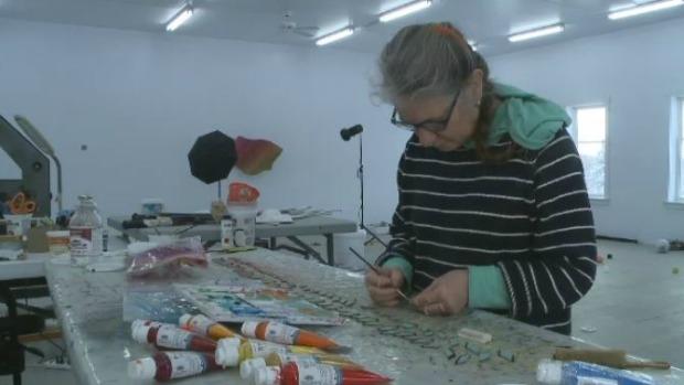 Artist Sydney Blum working in her art studio in Tatamagouche, N.S.