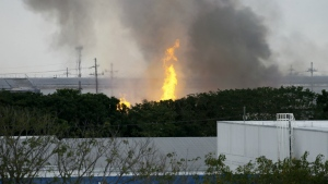 Flames rise from a huge fire at the House Technology Industries (HTI) factory inside the Export Processing Zone Authority for more than twenty hours in General Trias township, Cavite province south of Manila, Philippines on Thursday, Feb. 2, 2017. (AP / Bullit Marquez)