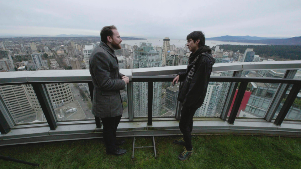 W5 reporter Jon Woodward with a rooftopper.