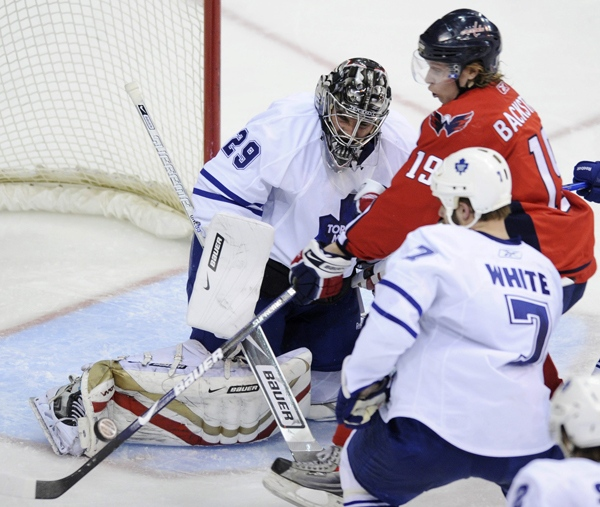 Washington Capitals' Nicklas Backstrom tries to work the puck against Toronto Maple Leafs goalie Martin Gerber and Toronto's Ian White during the third period in Washington, Thursday, March 5, 2009. (AP / Nick Wass)
