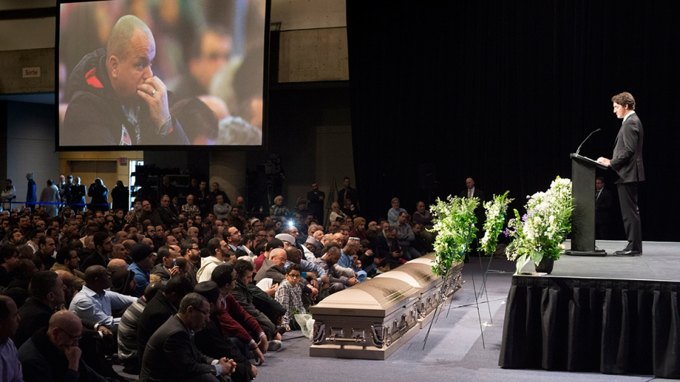 Prime Minister Justin Trudeau addresses mourners at a ceremony for three of the six victims of the Quebec City mosque shooting Friday, Feb. 3, 2017 in Quebec City. (Paul Chiasson / THE CANADIAN PRESS)