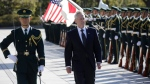 U.S. Defense Secretary Jim Mattis, right, is escorted to inspect an honor guard at Defense Ministry in Tokyo, Saturday, Feb. 4, 2017. (AP Photo / Eugene Hoshiko)