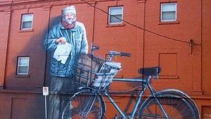 The mural of Walter Zilky Reusch is seen prior to building renovations. (CTV Winnipeg)