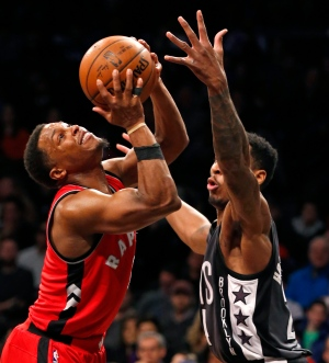 Brooklyn Nets forward Rondae Hollis-Jefferson, right, defends against Toronto Raptors guard Kyle Lowry, left, during the first half of an NBA basketball game, Sunday, Feb. 5, 2017, in New York. (AP / Kathy Willens)