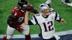 New England Patriots' Tom Brady passes under pressure from Atlanta Falcons' Grady Jarrett during the first half of the NFL Super Bowl 51 football game Sunday, Feb. 5, 2017, in Houston. (AP Photo/Charlie Riedel)