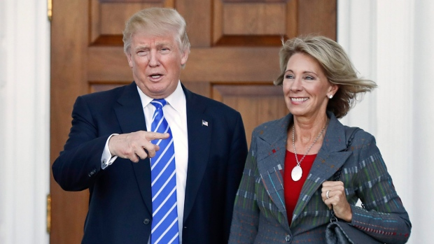 Donald Trump, left, and Betsy DeVos