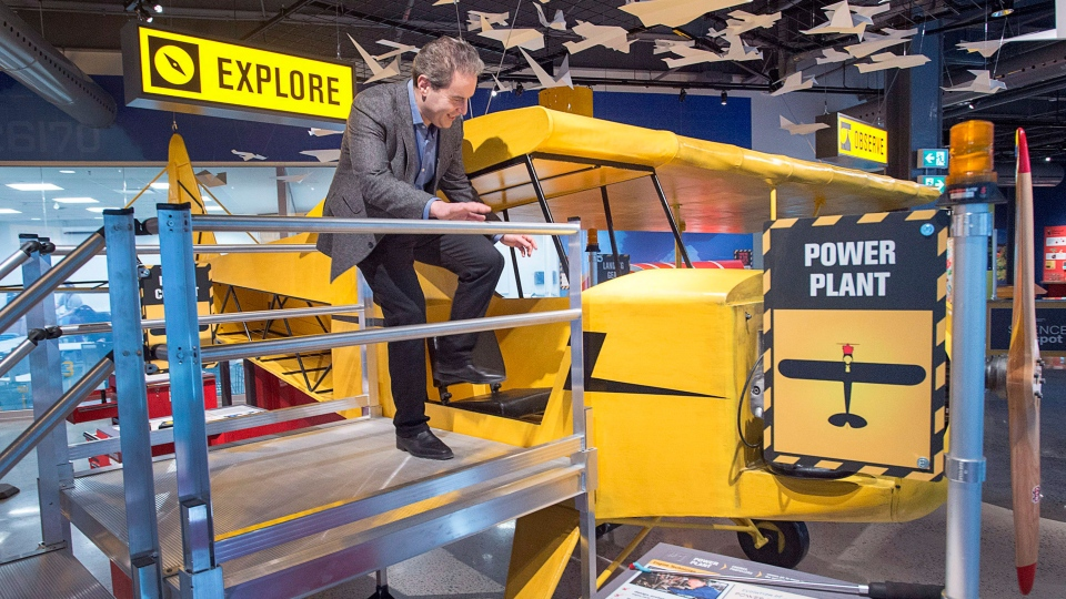 Dov Bercovici, president and CEO of the Discovery Centre, enters a static airplane exhibit at the Discovery Centre, an interactive science museum, in Halifax on Monday, Jan. 30, 2017. The newly constructed $20-million facility is seeking to attract people of all ages with travelling exhibits, interactive astronomy shows and invention workshops. (THE CANADIAN PRESS/Andrew Vaughan)