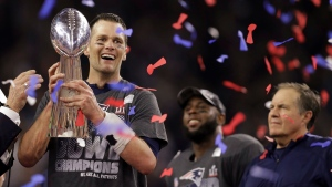 New England Patriots' Tom Brady holds the Vince Lombardi Trophy after defeating the Atlanta Falcons in overtime at the NFL Super Bowl 51 football game Sunday, Feb. 5, 2017, in Houston. (Darron Cummings/AP)