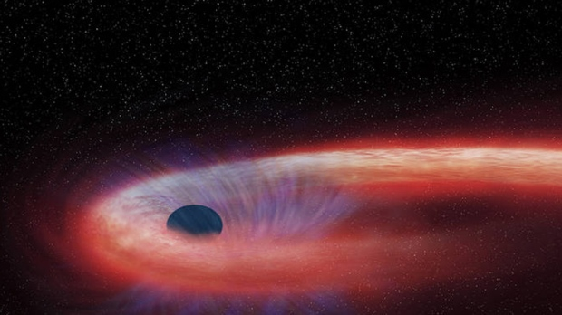 Binge Eater: Black hole taking over decade to devour star ...