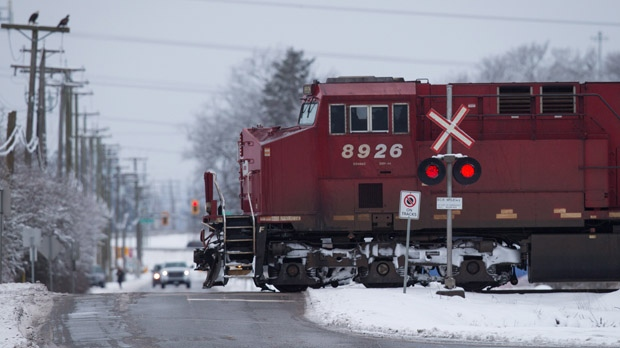 A Canadian Pacific Railway train passes through a crossing on a rural road in Delta, B.C., on Sunday February 5, 2017. THE CANADIAN PRESS/Darryl Dyck