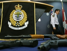 Vancouver Police Chief Jim Chu departs a news conference after announcing several gang related arrests as some of the weapons seized as part of the busts are displayed in Vancouver, B.C., on Friday, March 6, 2009. (THE CANADIAN PRESS / Darryl Dyck)