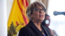 Finance Minister Cathy Rogers says the surplus is the result of a decrease in expenditures and a $150 million increase in revenues -- largely due to corporate income taxes.