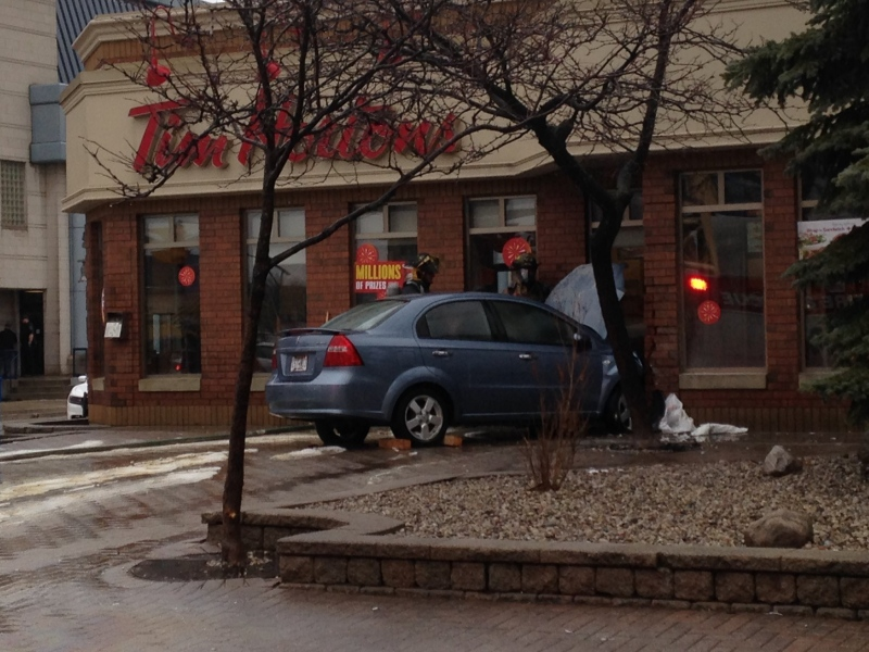 A Blue Pontiac Wave crashed into a Tim Hortons on Goyeau in Windsor, Ont., on Tuesday, Feb. 7, 2017. (Stefanie Masotti / CTV Windsor)