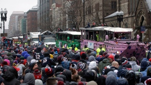 Fans cheer the New England Patriots riding on duck boats during a parade Tuesday, Feb. 7, 2017, in Boston to celebrate the team's 34-28 win over the Atlanta Falcons in Sunday's NFL Super Bowl 51 football game in Houston. (AP / Steven Senne)
