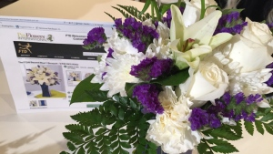 A bouquet is compared to a print-out of what was ordered online.