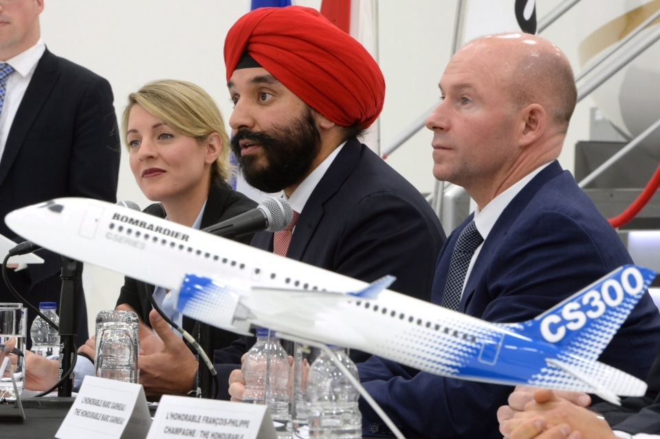 Heritage Minister Melanie Joly, left to right, Innovation Minister Navdeep Bains and Bombardier President and CEO Alain Bellemare look on during a press conference in Montreal on Tuesday, February 7, 2017. (Paul Chiasson / THE CANADIAN PRESS)