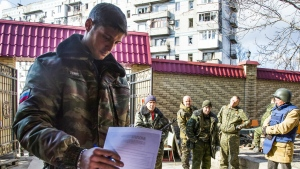 In this Nov. 2, 2014, file photo, a Pro-Russian rebel commander Mikhail Tolstykh, better known by his nom de guerre, Givi, casts his ballot during supreme council and presidential elections on the front line near Donetsk airport in the city of Donetsk, eastern Ukraine. (AP / Dmitry Lovetsky, file)
