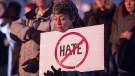 A woman holds a sign during a rally against Islamophobia in Vancouver, B.C., on Feb. 4, 2017. (Ben Nelms / THE CANADIAN PRESS)