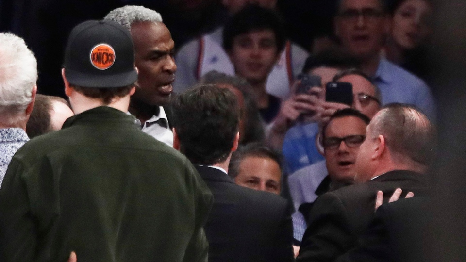 Former New York Knicks player Charles Oakley exchanges words with a security guard during the first half of an NBA basketball game between the New York Knicks and the LA Clippers, in New York, on Wednesday, Feb. 8, 2017. (AP Photo/Frank Franklin II)