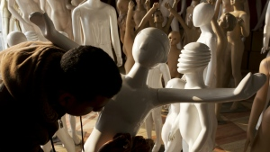 A worker removes dust from mannequins in a shop at Al-Kharqaniyah village, in the Egyptian province of Qalyubia, just outside Cairo, Egypt on Wednesday, Jan. 18, 2017. (AP / Amr Nabil)