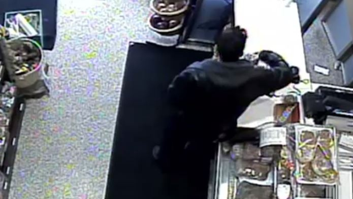 This surveillance image provided by Waterloo Regional Police shows a donation jar being stolen from a bakery on Elgin Street North in Cambridge.
