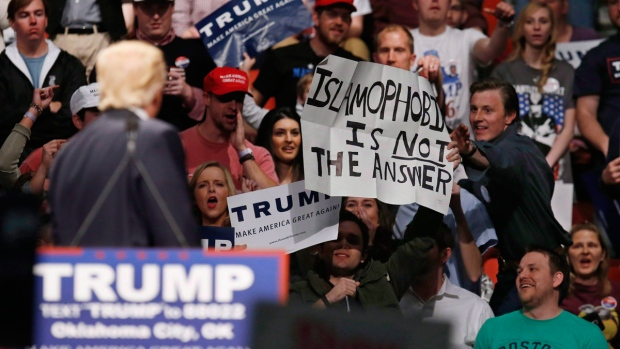 Trump supporter holds anti-Islamophobia sign