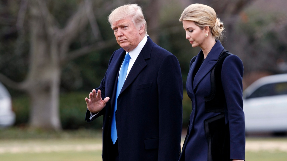 President Donald Trump, accompanied by his daughter Ivanka, waves as they walk on the South Lawn of the White House in Washington on Feb. 1, 2017.(Evan Vucci/AP)