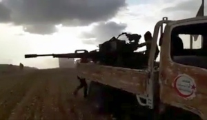 This frame grab from video provided by Baladi News Network, a Syrian opposition media outlet that is consistent with independent AP reporting, shows Turkey-backed Syrian opposition fighters fire their weapons during clashes with Syrian troops and pro-government gunmen, near the northern Syrian town of al-Bab, Aleppo province, Syria, Thursday, Feb. 9, 2017. (Baladi News Network, via AP)