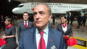Air Canada CEO Cavin Rovinescu speaks to the media after unveiling the airline's new uniforms in front of new lettering on one of the company's planes in Montreal, on Thursday, Feb. 9, 2017. (THE CANADIAN PRESS/Ryan Remiorz)