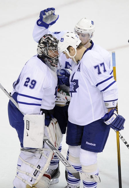 Toronto Maple Leafs' Pavel Kubina celebrates Toronto's 2-1 win with goalie Martin Gerber over the Washington Capitals in an NHL hockey game Thursday, March 5, 2009. (AP / Nick Wass)