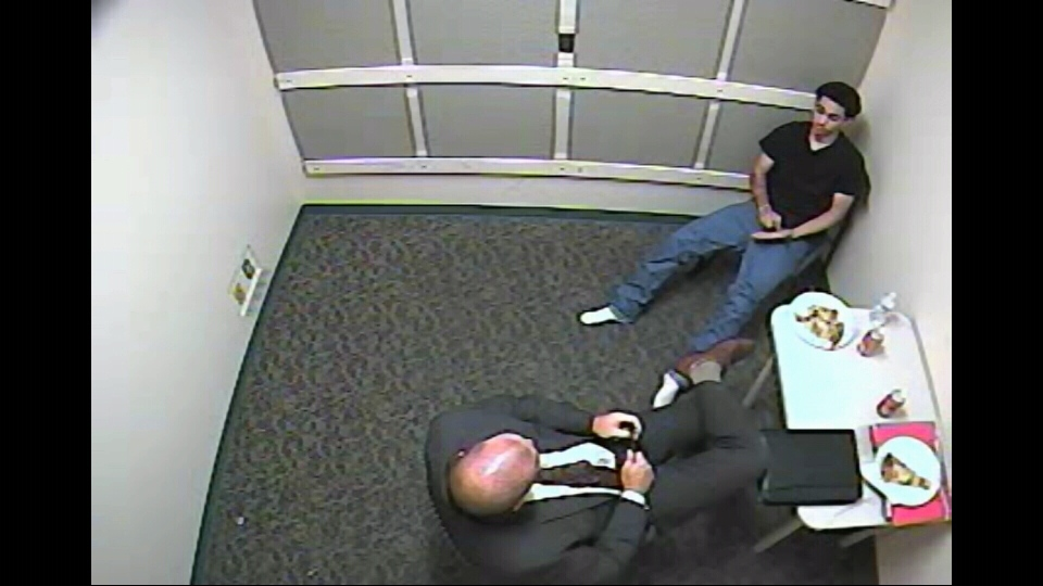 A scene from the Ottawa Police interrogation of Devontay Hackett following the 2014 stabbing death of Brandon Volpi.