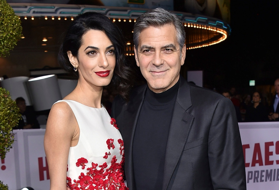 In this Feb. 1, 2016 file photo, Amal Clooney, left, and George Clooney arrive at the world premiere of 'Hail, Caesar!' in Los Angeles. The couple wed on Sept. 27, 2014, in Venice, Italy. (Photo by Jordan Strauss / Invision / AP)