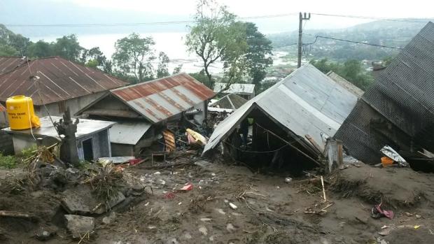 Landslides bury homes in Bali