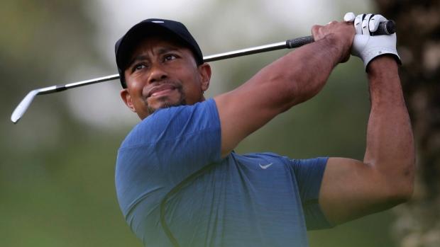 Tiger Woods tees off at the Dubai Desert Classic golf tournament on Feb. 2, 2017. (Kamran Jebreili / AP)