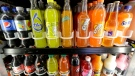 Soft drink and soda bottles are displayed in a refrigerator on Sept. 21, 2016. (AP Photo/Jeff Chiu, File)
