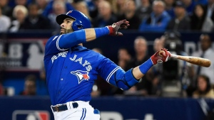 Toronto Blue Jays' Jose Bautista hits a solo home run against the Baltimore Orioles during the second inning of an American League wild-card baseball game in Toronto on Oct. 4, 2016. (Nathan Denette/The Canadian Press via AP, File)