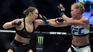 Ronda Rousey, left, and Holly Holm fight during their UFC 193 bantamweight title bout in Melbourne, Australia on Nov. 15, 2015. (AP Photo/Andy Brownbill)