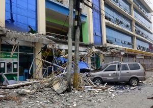 Fallen debris from a building is seen following a powerful nighttime earthquake that rocked Surigao city, Surigao del Norte province in southern Philippines, Saturday, Feb. 11, 2017. (AP)