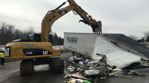 Crews worked to remove debris after two trucks collided on Highway 401 westbound. (Source: Abiey Lema/ CTV Kitchener)