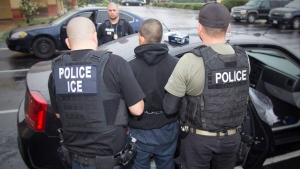 U.S. Immigration and Customs Enforcement agents arrest someone on Feb. 7, 2017 in a provided image. (Charles Reed / U.S. Immigration and Customs Enforcement via AP)