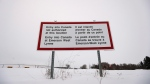 A sign is seen near Emerson, Man., on Thursday, Feb. 9, 2016. (John Woods / THE CANADIAN PRESS)