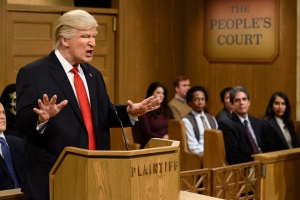 """This Saturday, Feb. 11, 2017, image released by NBC shows host Alec Baldwin as President Donald Trump during the """"Trump People's Court"""" in New York. (Will Heath/NBC via AP)"""