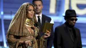 Beyonce accepts the award for best urban contemporary album for 'Lemonade' at the 59th annual Grammy Awards in Los Angeles on Sunday, Feb. 12, 2017. (Matt Sayles / Invision)
