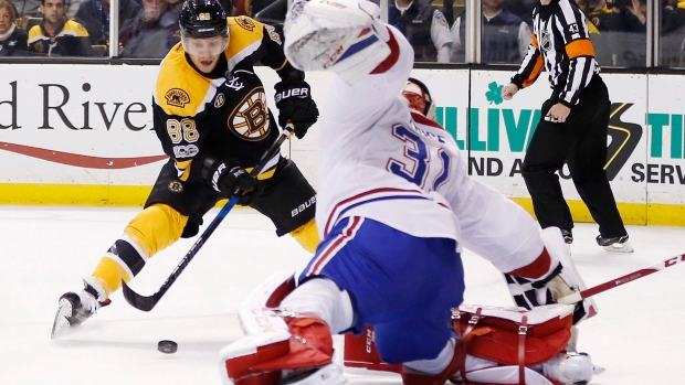 Boston Bruins' David Pastrnak (88), of the Czech Republic, sets up an unsuccessful shot on Montreal Canadiens' Carey Price (31) during the second period of an NHL hockey game in Boston, Sunday, Feb. 12, 2017. (AP Photo/Michael Dwyer)