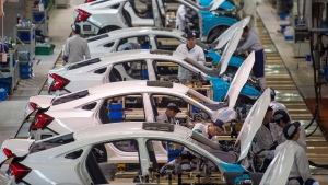 Workers assemble Honda Civic cars at Dongfeng Honda Automobile assembly plant in Wuhan in central China's Hubei province on Feb. 6, 2017. (Chinatopix via AP)