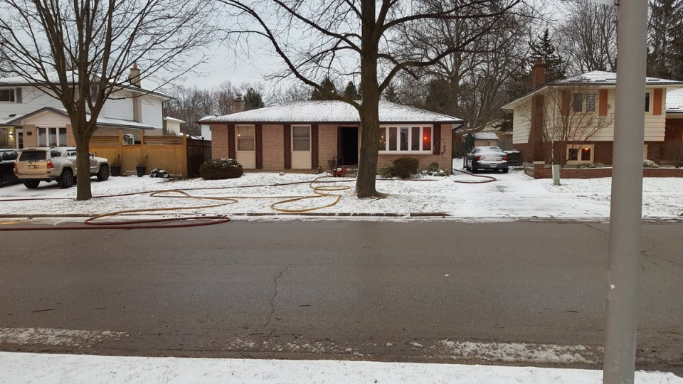 A home is ventilated after a basement and kitchen fire in London, Ont, on Monday, Feb. 13, 2017. (Justin Zadorsky / CTV London)