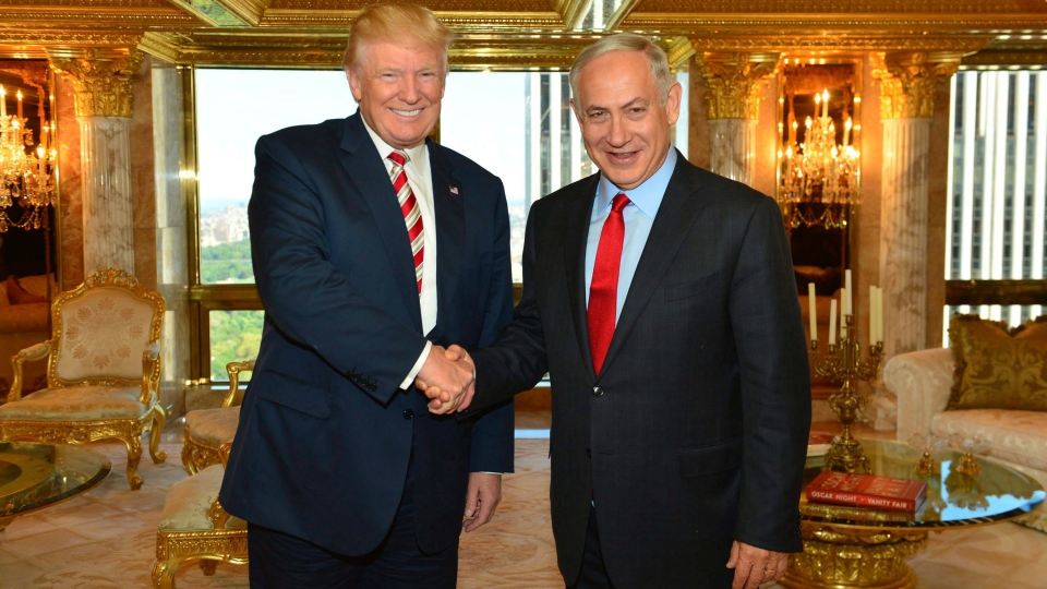 In this handout photo made on Sunday, Sept. 25, 2016, provided by the Israeli Government Press Office, Republican Presidential candidate Donald Trump shakes hand with Israeli Prime Minister Benjamin Netanyahu in New York. (Kobi Gideon, GPO via AP)