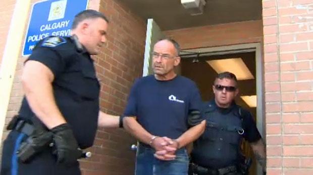 Douglas Garland in handcuffs.
